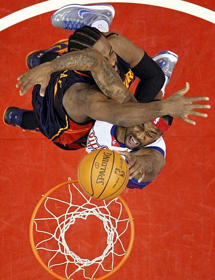 Los Angeles Clippers guard Bobby Brown, below, is fouled by Golden State Warriors center Ronny Turiaf during the first half of their NBA basketball game, Saturday, April 10, 2010, in Los Angeles. Photo: Mark J. Terrill, AP