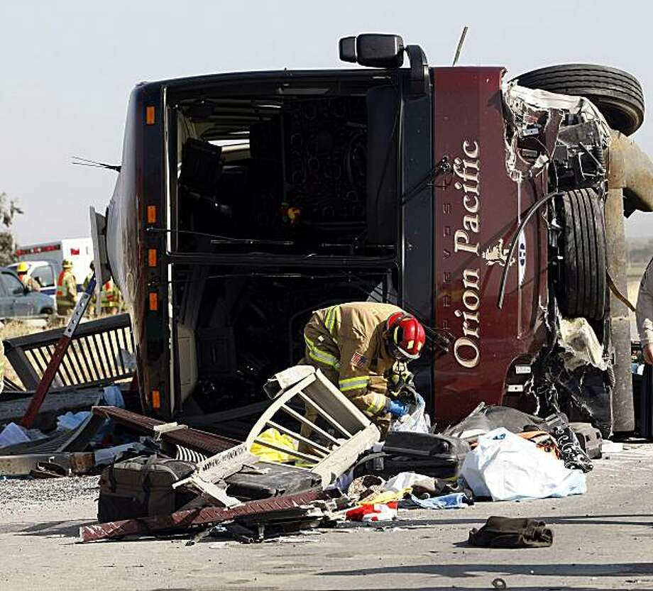 In this April 28, 2009 file photo, the scene of a multi-fatal accident involving a tour bus traveling south on Highway 101 near Soledad, Calif., is seen. Fatigue may have played a role in the bus crash last year that killed the vehicle's driver and four French tourists traveling through California on vacation, authorities said. (Monterey County herald, Vern Fisher) Photo: Vern Fisher, AP