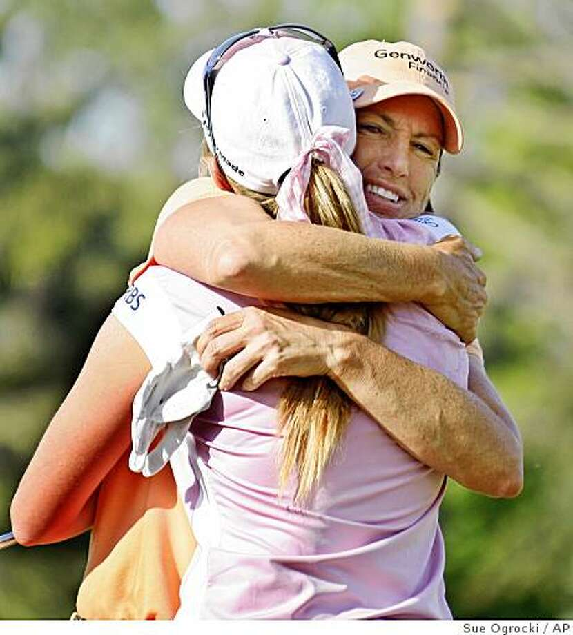 Juli Inkster, right, embraces Paula Creamer after Creamer defeated Inkster in a playoff during the final round of the LPGA's SemGroup Championship golf tournament at Cedar Ridge Country Club in Broken Arrow, Okla., Sunday, May 4, 2008. (AP Photo/Sue Ogrocki) Photo: Sue Ogrocki, AP