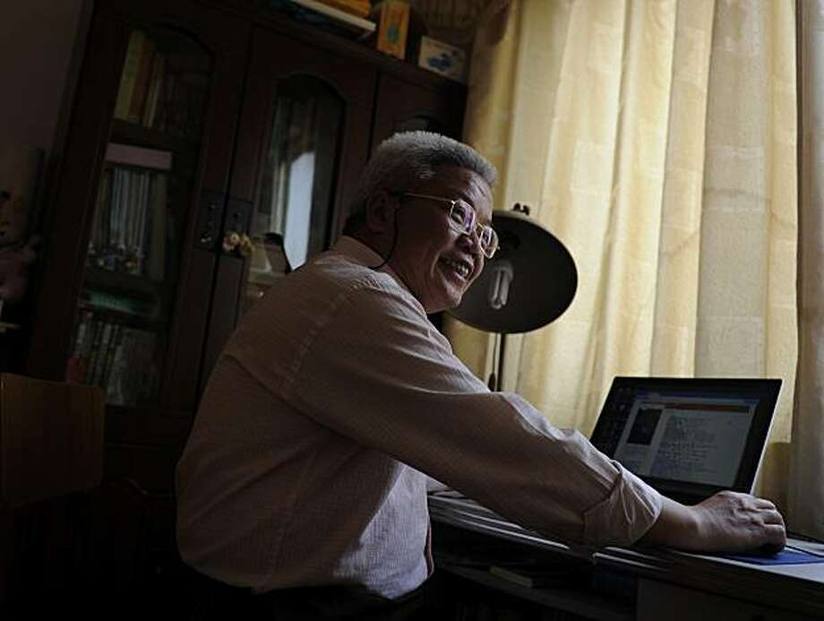 In this March 1, 2010 photo, former schoolteacher Lu Keqian speaks while checking his Web site at his home where he works, in Liuzhou, China. When professors in China need to author research papers to get promoted, many turn to ghostwriters like Lu. But the practice, along with plagiarizing or faking results, is so rampant in Chinese academia that some experts worry it could hinder China's efforts to become a leader in science. Photo: Andy Wong, AP