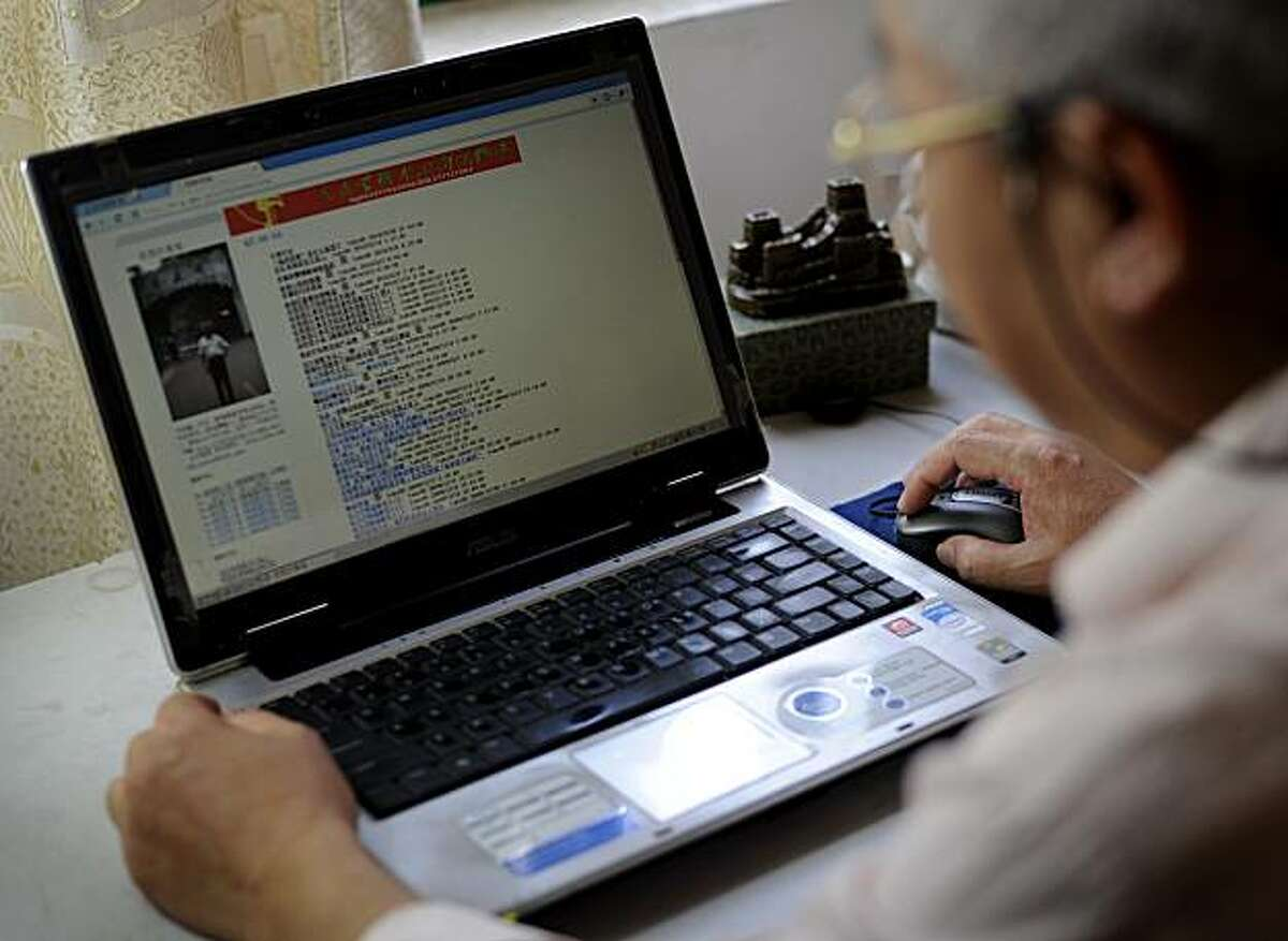 In this March 1, 2010 photo, former schoolteacher Lu Keqian checks his Web site at his home where he works, in Liuzhou, China. When professors in China need to author research papers to get promoted, many turn to ghostwriters like Lu. But the practice, along with plagiarizing or faking results, is so rampant in Chinese academia that some experts worry it could hinder China's efforts to become a leader in science.