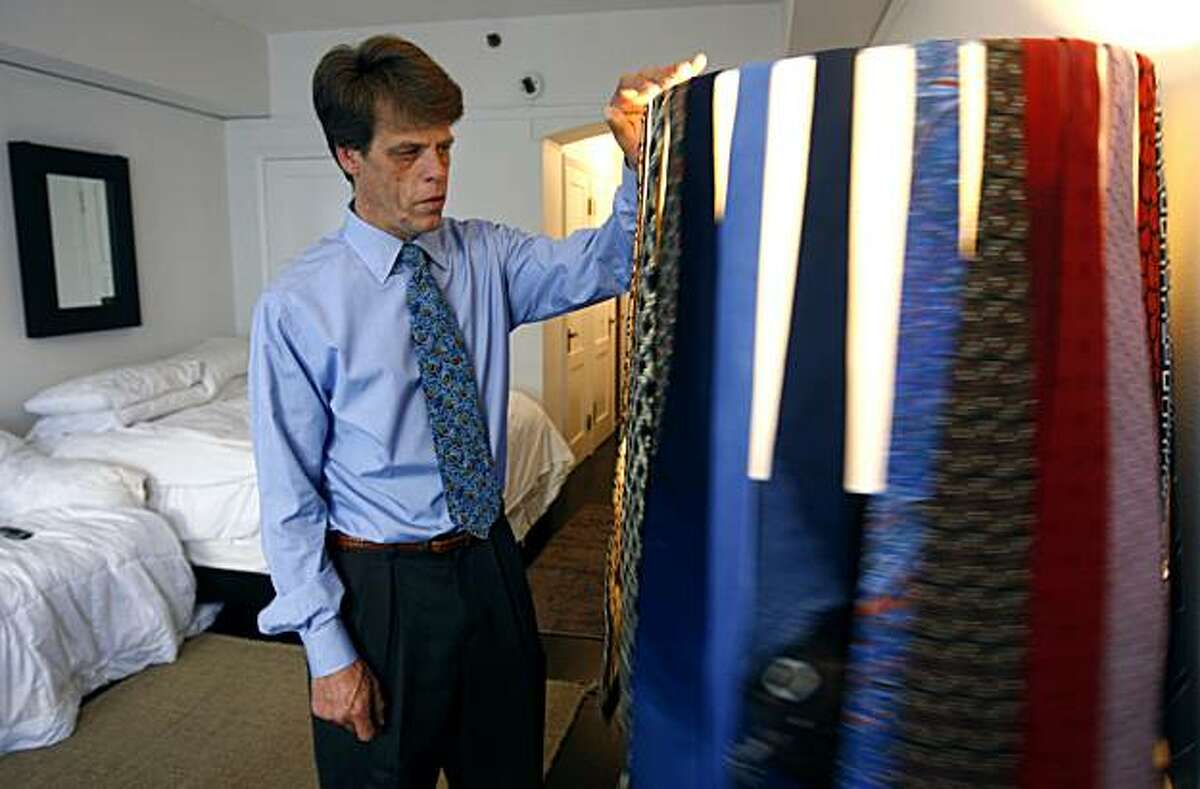 Larry Moore, who runs a shoeshine stand in the Financial District and was homeless living under the Bay Bridge a year ago, keeps a collection of neckties on a lamp shade in his room at the Gaylord Hotel on Jones Street in San Francisco, Calif., on Wednesday, April 7, 2010.