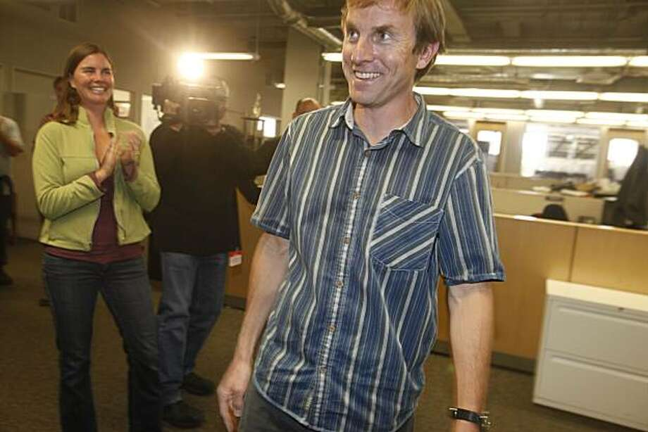 After winning the Pulitzer prize for editorial cartooning, with his wife Chelsea Donovan clapping by his side, Mark Fiore, animated cartoonist for sfGate.com, is congratulated by friends and colleagues  in the Sfgate offices on Monday April 12, 2010 in Berkeley, Calif. Photo: Mike Kepka, The Chronicle