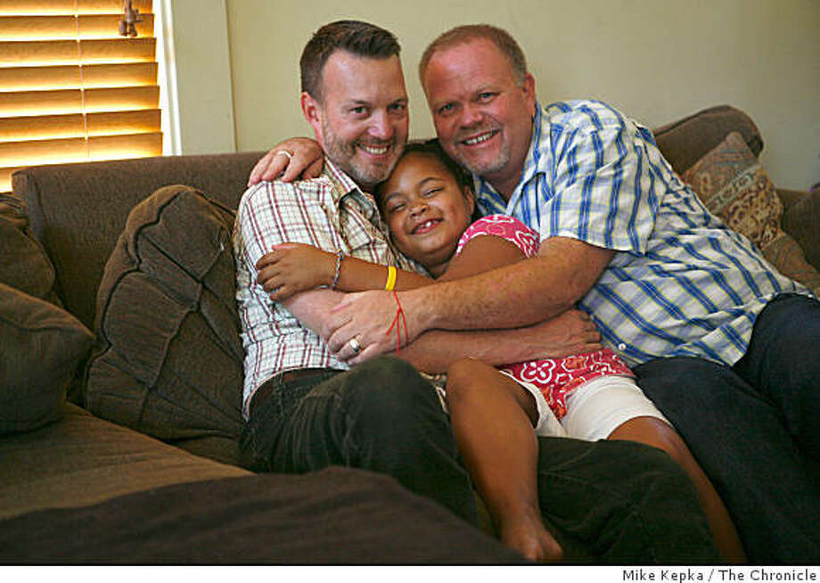 Together for 20 years, Gary Walker and Ed Valenzuela hug their daughter Kiki Valenzuela, 7, on their couch on Saturday Sept. 6, 2008 in Berkeley, Calif. Photo: Mike Kepka, The Chronicle