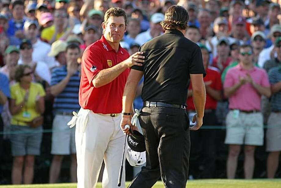 AUGUSTA, GA - APRIL 11:  Phil Mickelson (R) shakes hands with Lee Westwood of England on the 18th green after Mickelson's three-stroke victory at the 2010 Masters Tournament at Augusta National Golf Club on April 11, 2010 in Augusta, Georgia. Photo: Jamie Squire, Getty Images