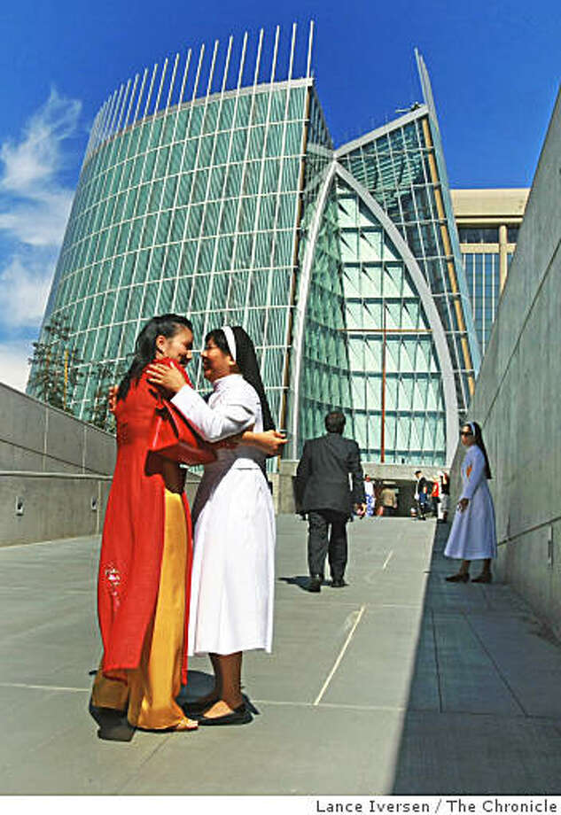 Vicki Nguyen from San Lorenso hugs Sister Christine Le from holly Cross  outside the new Cathedral of Light Thursday, Sept. 25, 2008, in Oakland, Calif. Hundreds of parishioners joined priests from throughout the state and four attending Cardinals for the ceremony. Photo: Lance Iversen, The Chronicle
