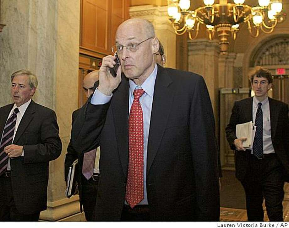 Talking on his cell phone, Secretary of the Treasury Henry Paulson enters the Capitol for a late night meeting with members of Congress including Senate Majority Leader Sen. Harry Reid, D-Nev., Senate Banking, Housing and Urban Affairs Chairman Sen. Christopher Dodd and House Financial Services Chairman Rep. Barney Frank, D-Mass., on Capitol Hill Thursday, Sept. 25, 2008 in Washington. (AP Photo/Lauren Victoria Burke) Photo: Lauren Victoria Burke, AP