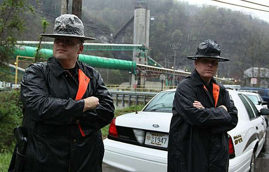 MONTCOAL, WV - APRIL 08: Two officers with the Raleigh County Sheriff Department stand guard in front of the Upper Big Branch Mine on April 8, 2010 in Montcoal, West Virginia. The search for three unaccounted miners has been suspended due to dangerous gasses trapped underground. Twenty-five miners were killed in an explosion at Massey Energy Company's Upper Big Branch Coal Mine April 5. Photo: Mark Wilson, Getty Images