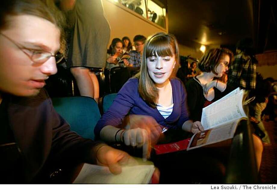 """Emily Trumble, 17 (right) looks over the program with Alex Tarczynsky, 17, (left) before they watch """"Spring Awakening"""" at the Curran Theater on Thursday, September 25, 2008 in San Francisco, Calif. Photo: Lea Suzuki,, The Chronicle"""