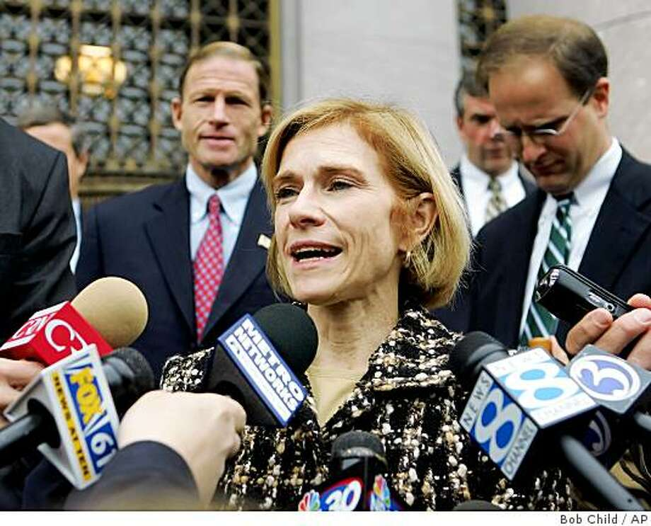 In this Oct. 25, 2005 file photo, Assistant U.S. Attorney Nora Dannehy speaks to reporters outside U.S. District Court in New Haven, Conn. Dannehy, a career prosecutor was appointed on Monday  to pursue possible criminal charges against Republicans who were involved in the controversial firings of U.S. attorneys. Photo: Bob Child, AP