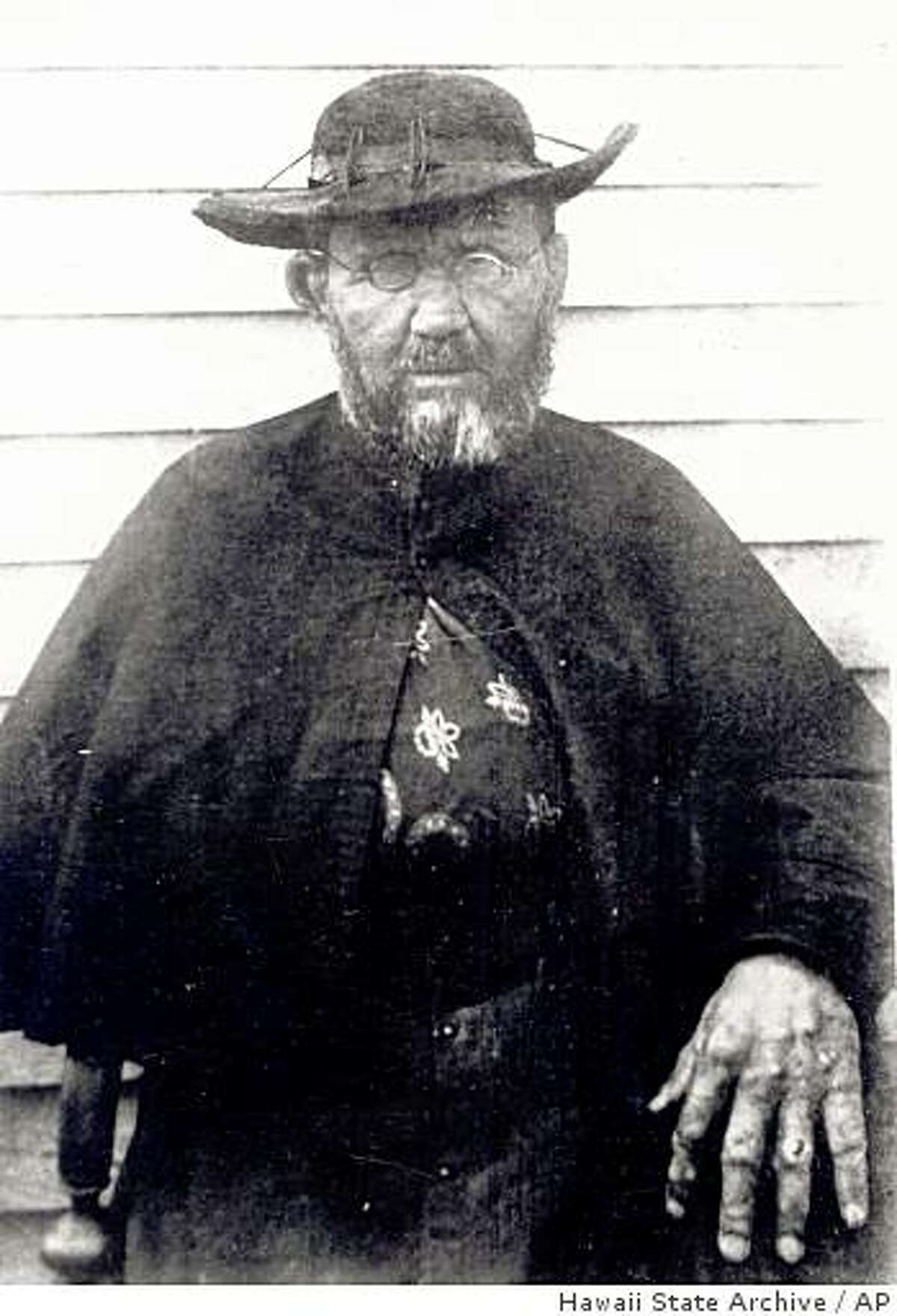 In this photo provided by Hawaii State Archive, Father Damien is seen in this portrait taken two months before his death in 1889 at the leprosy settlement in Kalaupapa, Hawaii. The two dozen patients still living at Kalaupapa are eager to celebrate Damien's expected canonization, but they don't want throngs of pilgrims disturbing the community's privacy and desecrating the land. (AP Photos/Hawaii State Archive)
