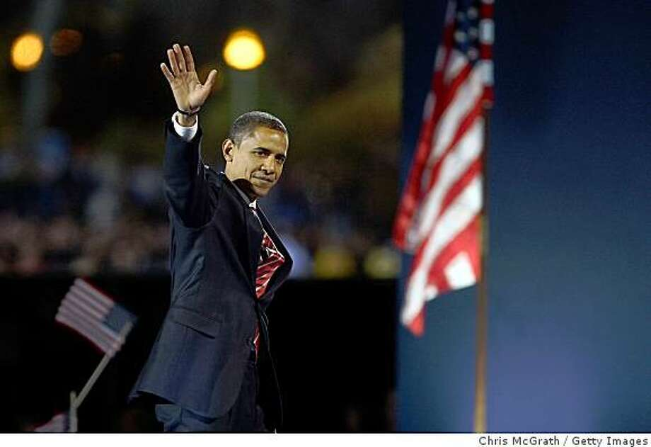 CHICAGO - NOVEMBER 04:  U.S. President elect Barack Obama waves to his supporters during his victory speech at an election night gathering in Grant Park on November 4, 2008 in Chicago, Illinois. Obama defeated Republican nominee Sen. John McCain (R-AZ) by a wide margin in the election to become the first African-American U.S. President elect.  (Photo by Chris McGrath/Getty Images) Photo: Chris McGrath, Getty Images
