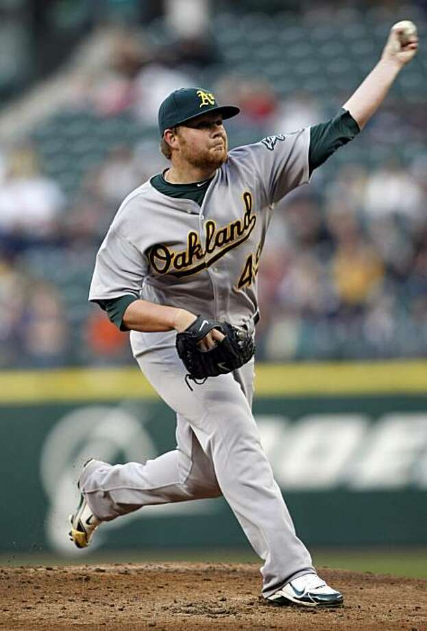 Oakland Athletics starting pitcher Brett Anderson works against the Seattle Mariners during the first inning of a baseball game in Seattle on Tuesday, April 13, 2010. Photo: John Froschauer, AP