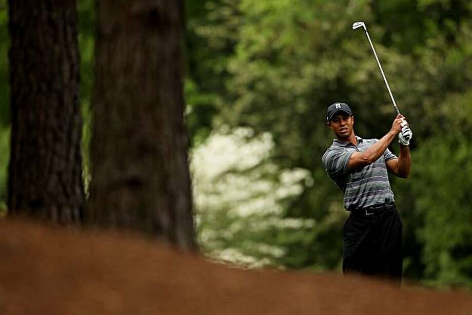 AUGUSTA, GA - APRIL 08:  Tiger Woods plays his second shot on the 11th hole during the first round of the 2010 Masters Tournament at Augusta National Golf Club on April 8, 2010 in Augusta, Georgia. Photo: Andrew Redington, Getty Images