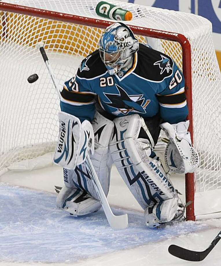 San Jose Sharks goalie Evgeni Nabokov (20) blocks a shot in the first period of an NHL hockey game against the Phoenix Coyotes in San Jose, Calif., Saturday, April 10, 2010. Photo: Paul Sakuma, AP