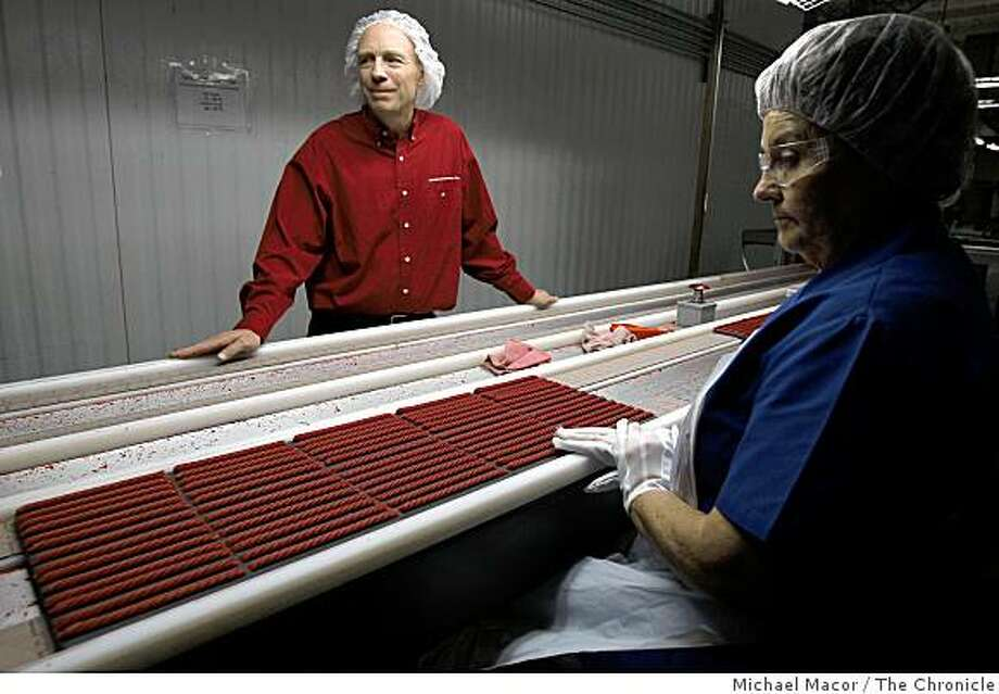 John Nelson,  is the plant manager of the American Licorice Company in Union Cty, Calif. On the production line with 16 year employee Irene Quiroga, on Wednesday Sept. 24, 2008. Photo: Michael Macor, The Chronicle