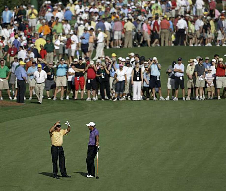 Mark O'Meara, left and Tiger Woods chat while waiting to play through on the seventh fairway during a practice round at the Masters golf tournament in Augusta, Ga., Wednesday, April 7, 2010. The tournament begins Thursday, April, 8. Photo: David J. Phillip, AP