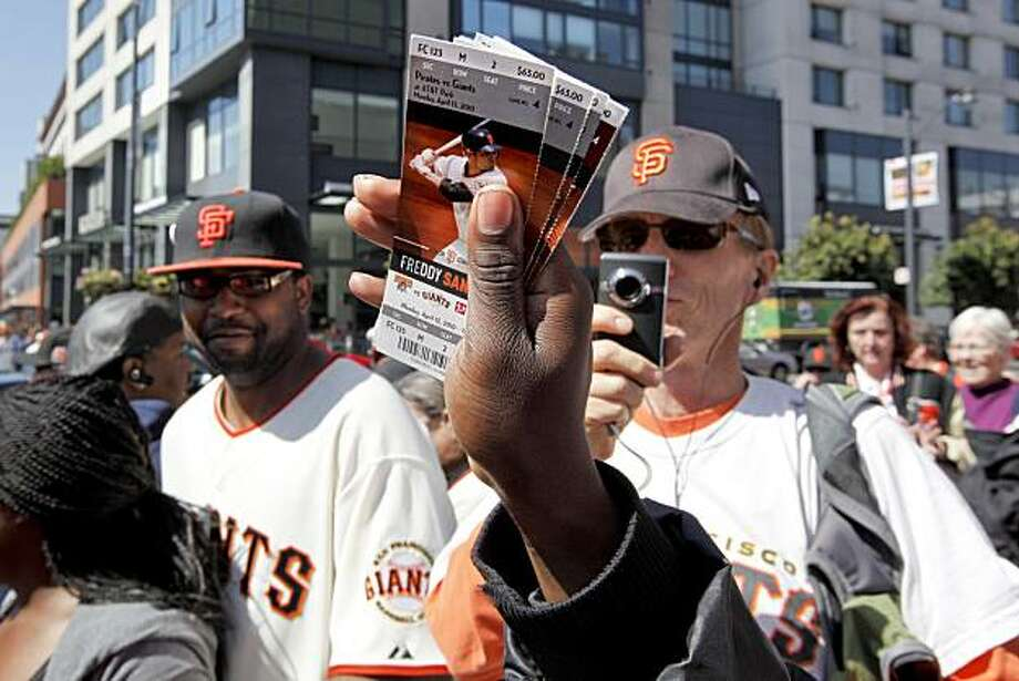 Jerome Brousdsard, is even selling  tickets for the weekend games as scalpers were out in force across the street from the ballpark for the home opener of season,  in San Francisco, Calif. on Apr. 9, 2010. Photo: Michael Macor, The Chronicle