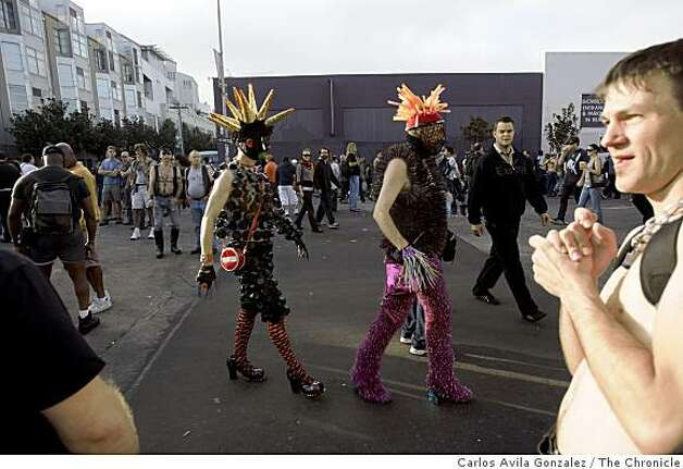 Two costumed participants attend the Folsom Street Fair. Photo: Carlos Avila Gonzalez, The Chronicle