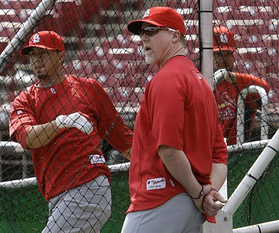 St. Louis Cardinals batting coach Mark McGwire, front, watches batting practice Sunday, April 4, 2010, in Cincinnati. The Cardinals play the Cincinnati Reds on Monday in Cincinnati in the season opener for both clubs. Photo: Al Behrman, AP
