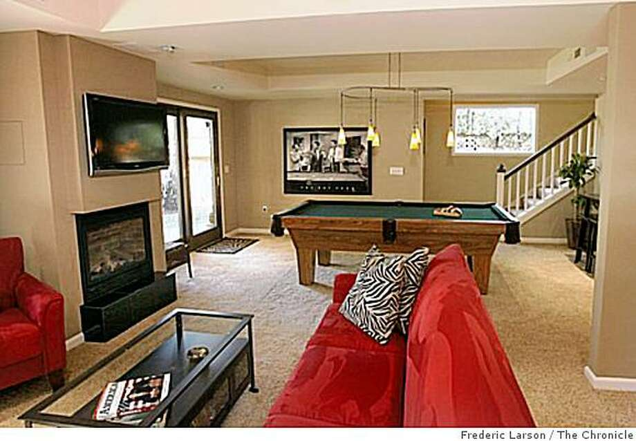A basement becomes a relaxing recreation room. Photo: Frederic Larson, The Chronicle