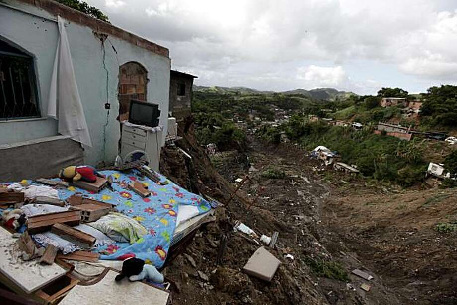 A home lays in ruins after a landslide in the Morro do Bumba neighborhood of Niteroi near Rio de Janeiro, Thursday, April 8, 2010.  As many as 200 people were buried under tons of mud and feared dead on Thursday after a slum built atop a former landfill gave way in the latest deadly landslide to hit metro Rio de Janeiro. Photo: Felipe Dana, AP