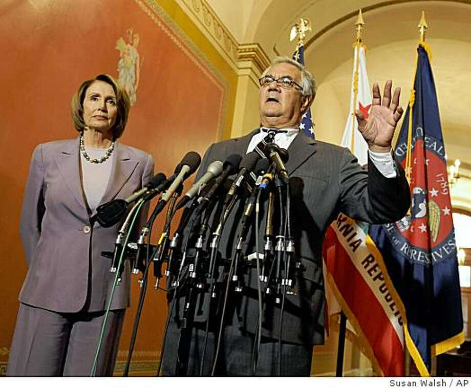 Speaker of the House Nancy Pelosi, D-Calif., left, listens as House Financial Services Committee Chairman Barney Frank, D-Mass., speaks about the financial market turmoil at a news conference on Capitol Hill in Washington, Friday, Sept. 26, 2008. Photo: Susan Walsh, AP