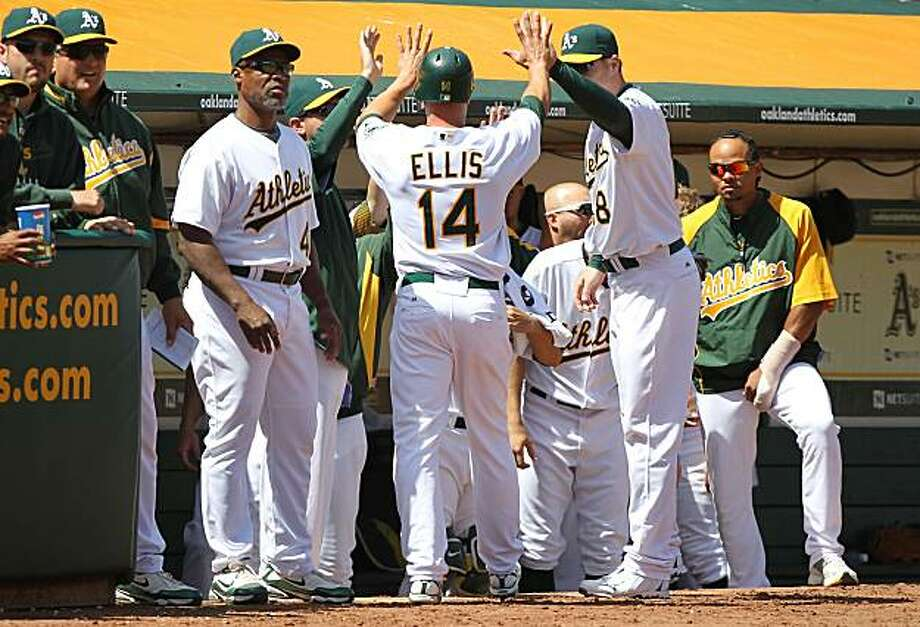OAKLAND, CA - APRIL 08:  Mark Ellis #14 of the Oakland Athletics celebrates after scoring on an Daric Barton single in the 4th inning against the Seattle Mariners during an MLB game at the Oakland-Alameda County Coliseum on April 8, 2010 in Oakland, California. Photo: Jed Jacobsohn, Getty Images