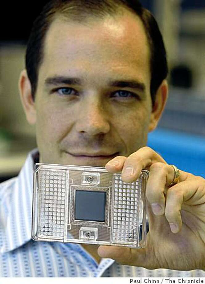 Gajus Worthington, president and CEO of Fluidigm Corp., holds a genetic detection chip that his firm designs and manufactures in South San Francisco, Calif., on Thursday, Sept. 25, 2008. Fluidigm was in the process of going public but withdrew the IPO after the market took a nosedive. Photo: Paul Chinn, The Chronicle