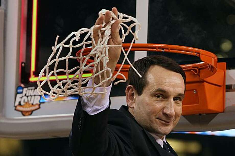 Duke head coach Mike Krzyzewski holds up the net after defeating Butler 61-59 in the NCAA Final Four championship game at Lucas Oil Stadiuim in Indianapolis, Indiana, Monday, April 5, 2010. (Chuck Liddy/Raleigh News & Observer/MCT) Photo: Chuck Liddy, MCT