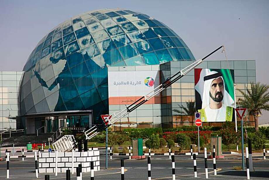 "A billboard displays a picture of Sheik Mohammed bin Rashid Al Maktoum at the Global Village in Dubai, United Arab Emirates, on Thursday, April 8, 2010. Dubai's government can find the money to support Dubai World's debt restructuring plan and the emirate's economic problems are ""temporary,"" Reuters reported, citing the vice chairman of its Supreme Fiscal Committee. Photographer: Gabriela Maj/Bloomberg Photo: Gabriela Maj, Bloomberg"