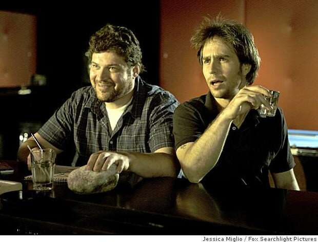 "Brad William Henke, left, and Sam Rockwell are shown in a scene from ""Choke."" Photo: Jessica Miglio, Fox Searchlight Pictures"