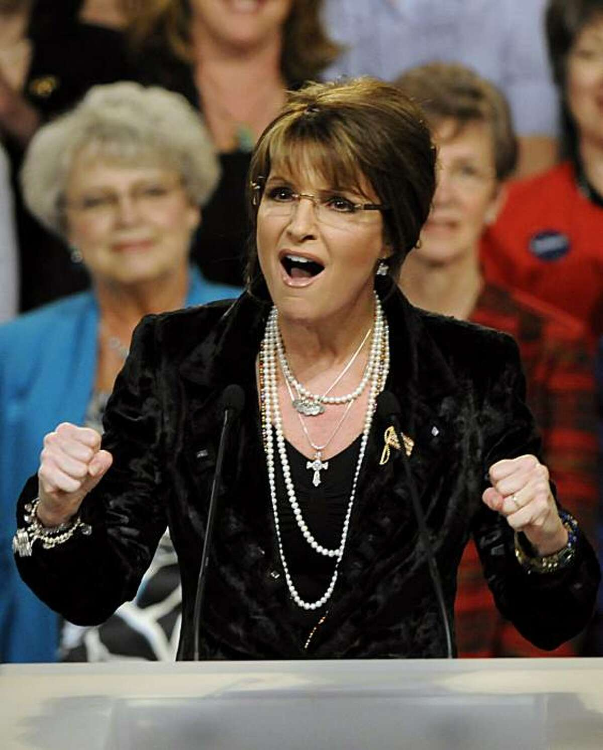 Sarah Palin addresses a Minnesota Republican Party rally for Rep. Michele Bachmann, R-Minn., Wednesday April 7, 2010 in Minneapolis.