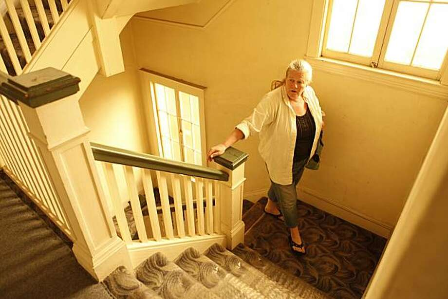 To get to the apartment she's lived in for the past 8 years at 850 Geary Street, Renee Valentine walks up five flights of stairs  on Wednesday April 4, 2010 in San Francisco, Calif. The elevator in her building has been out of service for the past month. Photo: Mike Kepka, The Chronicle