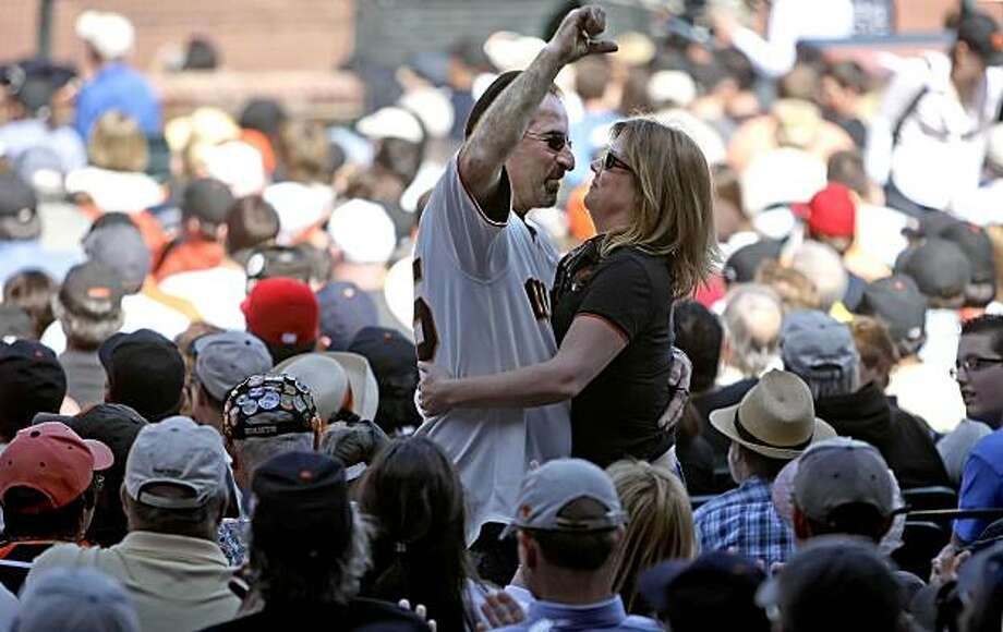 Greg Van Cleave and Stephanie Lee, not only enjoyed  the home opener of season, but Stephanie said yes to a marriage proposal in the 4th inning from Greg at AT&T Ballpark in San Francisco, Calif. on Apr. 9, 2010. Photo: Michael Macor, The Chronicle