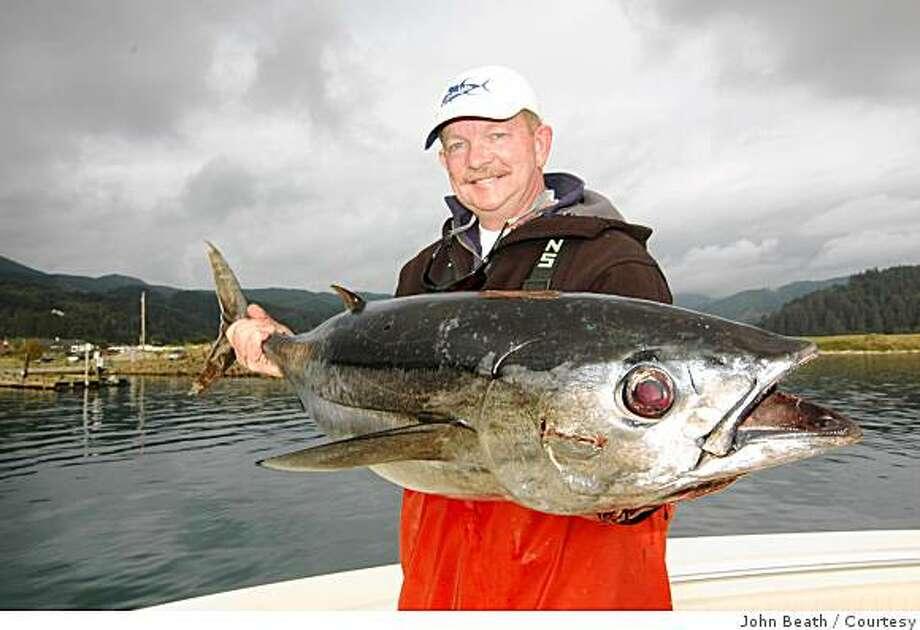Del Stephens holds a 35-pound tuna caught off the coast of Oregon Photo: John Beath, Courtesy