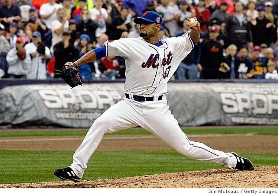 NEW YORK - SEPTEMBER 27:  Johan Santana #57 of the New York Mets pitches against the Florida Marlins on September 27, 2008 at Shea Stadium in the Flushing neighborhood of the Queens borough of New York City.  (Photo by Jim McIsaac/Getty Images) Photo: Getty Images