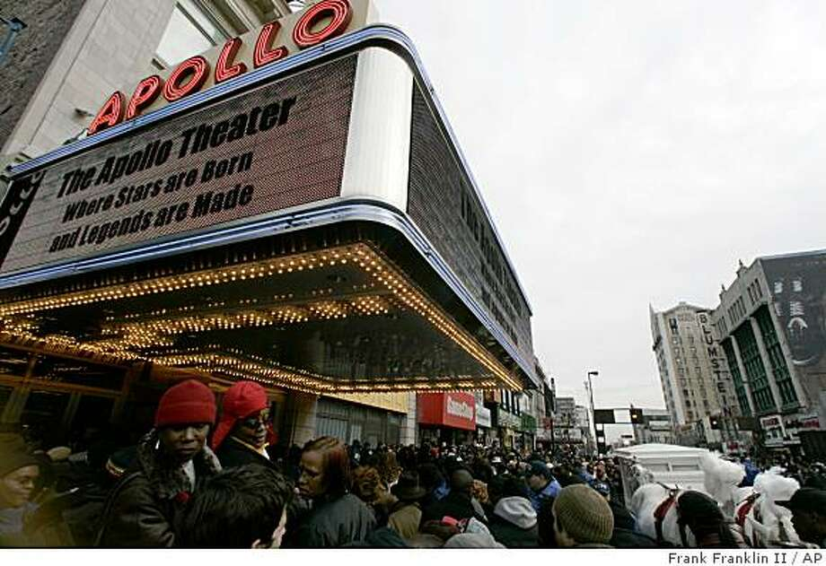 ** FILE ** In this Dec. 28, 2006 file photo, fans of the late singer James Brown gather to pay their respects at the Apollo Theater in New York. The Apollo Theater, which was one of the 87 cultural institutions supported by Lehman Brothers, said it couldn't comment on the remainder of the $1 million it had been slated to receive over four years. (AP Photo/Frank Franklin II, file) Photo: Frank Franklin II, AP