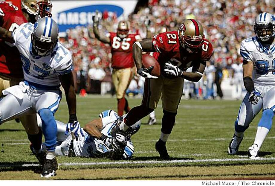 San Francisco 49ers Frank Gore (21) goes in for a score in the second quarter as Detroit Lions Paris Lenon (53) can't make the stop, as San Francisco 49ers take on the Detroit Lions in NFL action at Candlestick Park in San Francisco, Calif. on Sunday Sept. 21, 2008. Photo: Michael Macor, The Chronicle