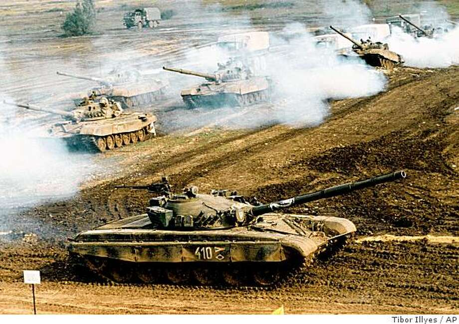 ** FILE ** In this Oct. 1998 file photo, Hungarian T-72 armored tanks maneuver during a military drill in Veszprem, Hungary. Russia's navy dispatched a warship to Somalia's coast, officials said Friday Sept. 26, 2008, a day after pirates seized a Ukrainian vessel carrying Russian and Ukranian crew and loaded with 33 T-72 tanks and ammunition bound for Kenya.(AP Photo/MTI,Tibor Illyes, File) Photo: Tibor Illyes, AP