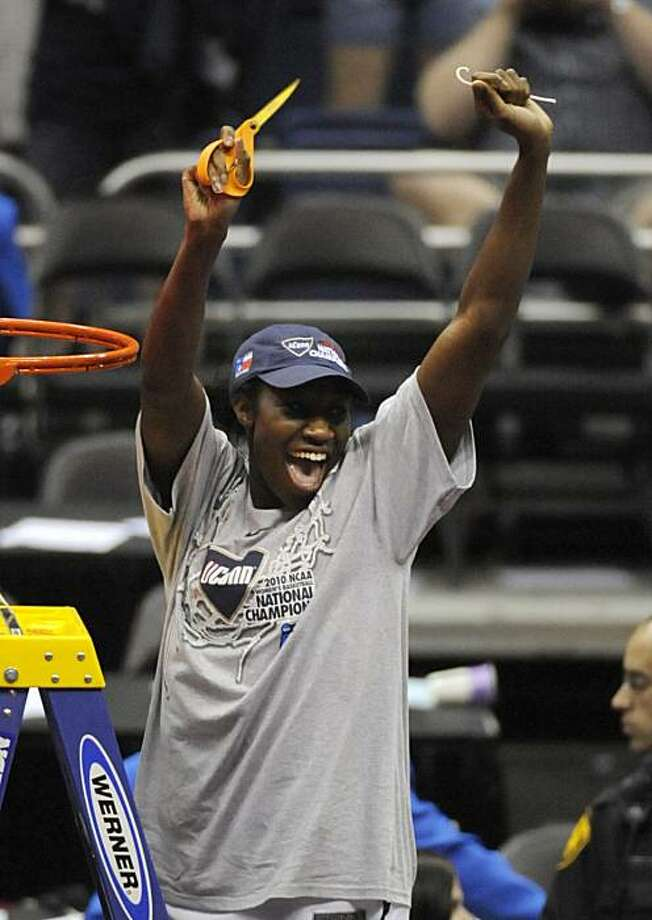 Connecticut's Tina Charles celebrates after cutting a link off the net following the women's NCAA Final Four college basketball championship game against Stanford Tuesday, April 6, 2010, in San Antonio. Connecticut won 53-47. Photo: Pat Sullivan, AP