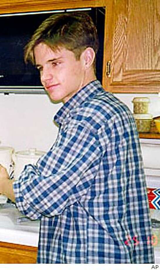 ** FILE **In this undated file photo Matthew Shepard, 22, is shown. Shepard was beaten, burned and tied to a wooden ranch fence near Laramie, Wyo., Wednesday, Oct. 7, 1998, reportedly for being openly gay. Shepard's parents spoke at a ceremony Saturday, Sept. 27, 2008, dedicating a bench to their son. In addition, University of Wyoming President Tom Buchanan said his college has established an annual social justice symposium named after Shepard; created a resource center to support gays, lesbians, bisexuals and others; and developed a center for social justice to research and expose sources of inequity in society. (AP Photo/File) ** NO SALES ** Photo: AP