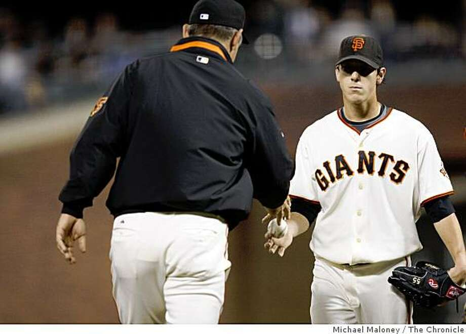 San Francisco Giants starting pitcher Tim Lincecum gives the ball to manager Bruce Bochy after he was relieved by Keiichi Yabu in the 5th inning against the Colorado Rockies at AT&T Park in San Francisco, Calif., on Sept. 23, 2008. Photo: Michael Maloney, The Chronicle