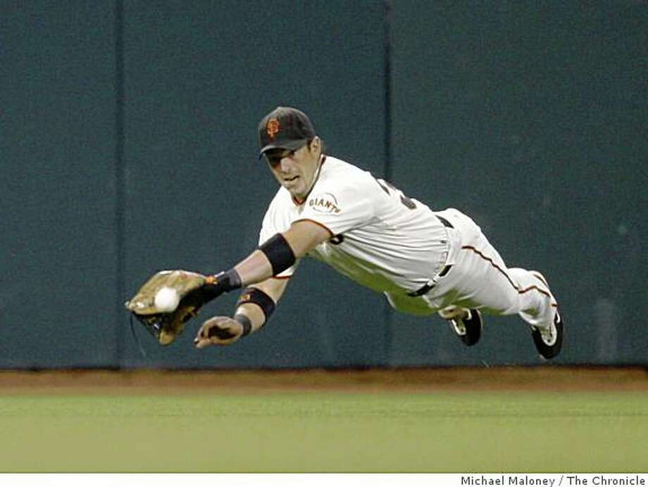 San Francisco Giants Outfielder Aaron Rowand can't come up with the catch, but holds Colorado Rockies Seth Smith to a single in the 5th inning at AT&T Park in San Francisco, Calif., on Sept. 23, 2008. Photo: Michael Maloney, The Chronicle