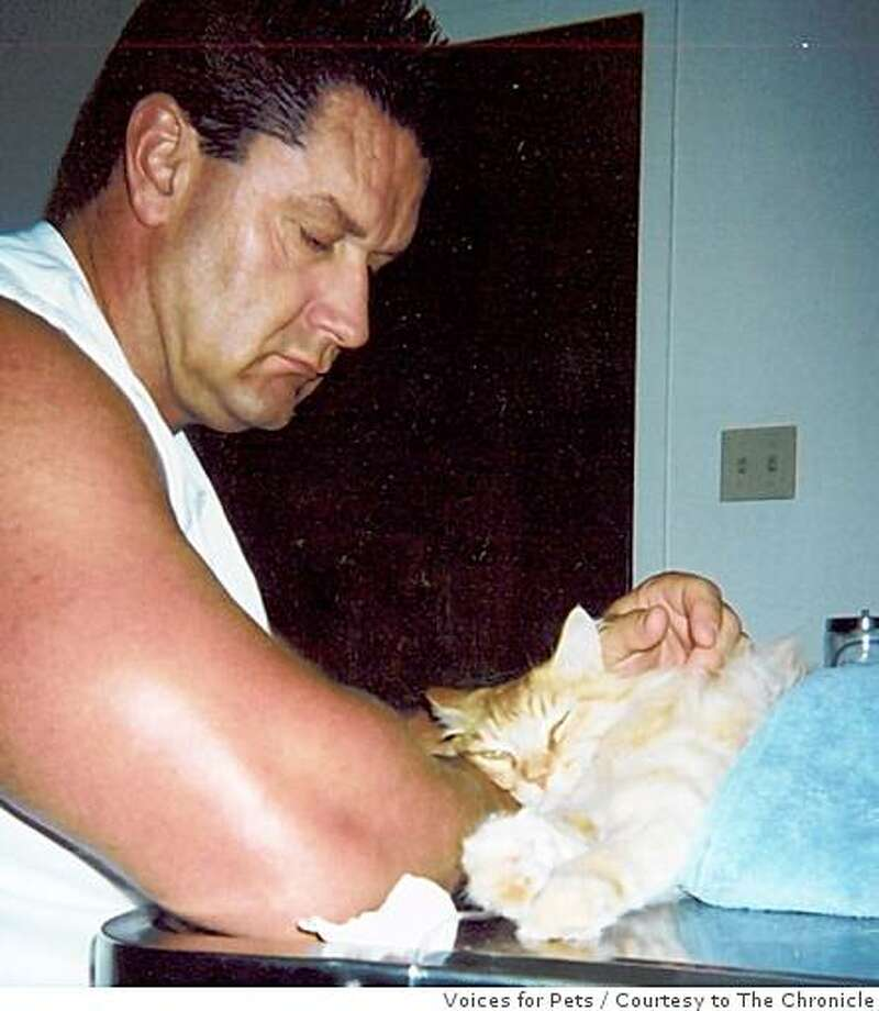 Kevin Kimes of Brentwood and his cat Pumkin (cq) after the latter was wounded in a pellet-gun shooting in October 2005. Kimes is now in trouble for publicizing his suspicion that his next-door neighbor did the shooting, which the neighbor denies. Photo: Voices For Pets, Courtesy To The Chronicle