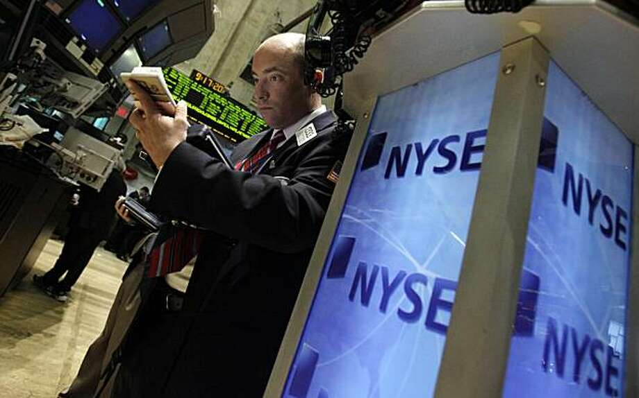 Trader Christopher Moire works on the floor of the New York Stock Exchange, Wednesday, April 7, 2010. Photo: Richard Drew, AP