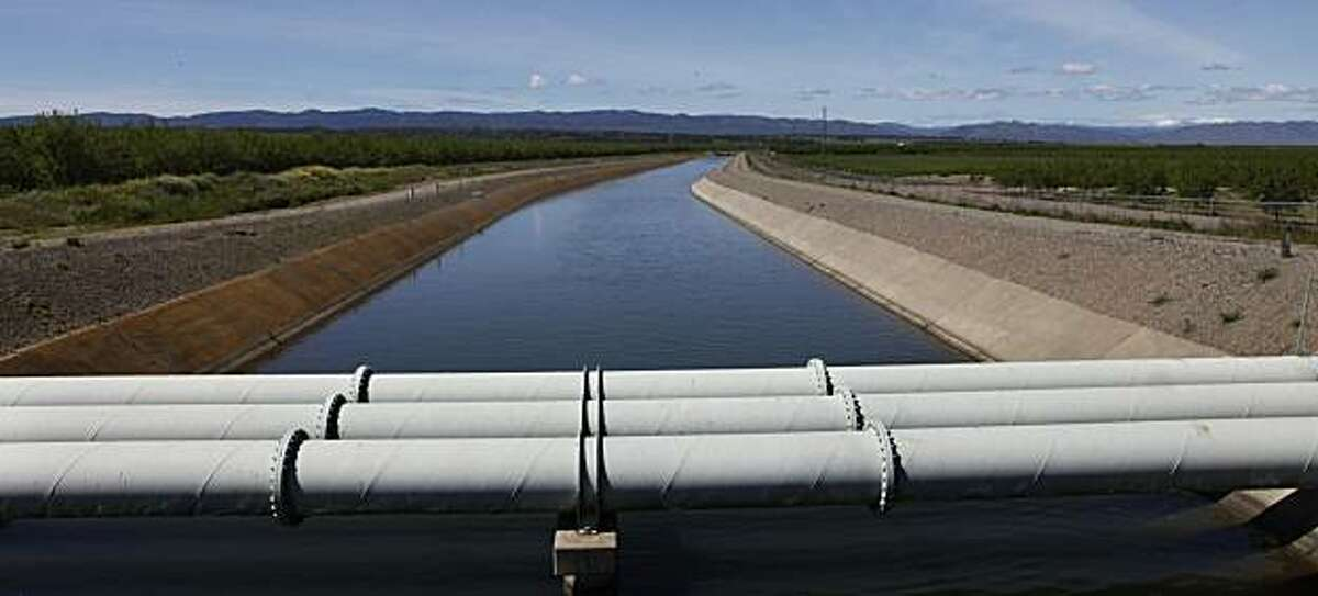 A water cannel passes through Arbuckle, Calif., as it delivers water to farmers on Tuesday, April 6, 2010.