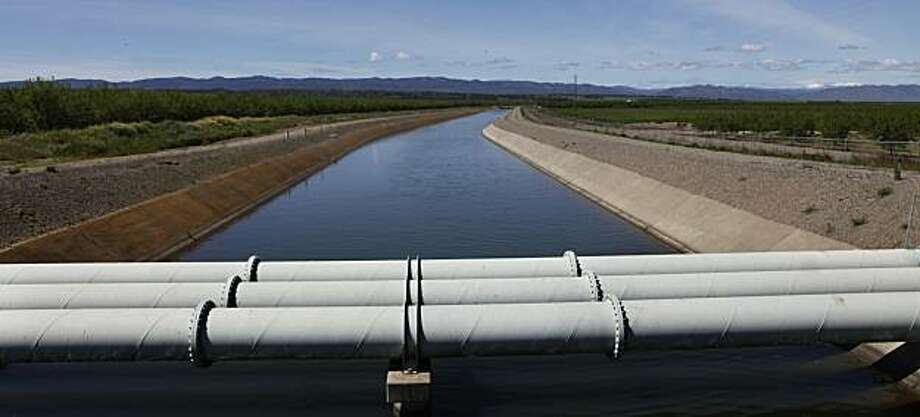 A water cannel passes through Arbuckle, Calif., as it delivers water to farmers on Tuesday, April 6, 2010. Photo: Lance Iversen, The Chronicle