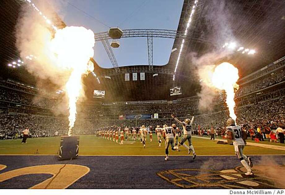 Dallas Cowboy players enter the field for the start of an NFL football game against the Philadelphia Eagles at Texas Stadium in Irving, Texas, Monday, Sept. 15, 2008. The Cowboys won 41-37. (AP Photo/Donna McWilliam) Photo: Donna McWilliam, AP