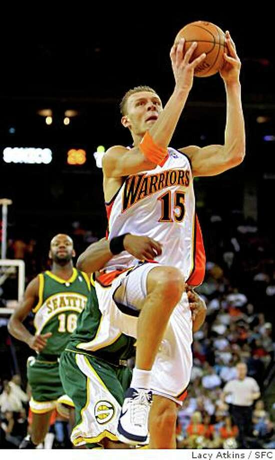 Golden State Warriors Andris Biedrins scores a basket against the Seattle Sonics, Wednesday April 16, 2008, in Oakland, Calif. Photo: Lacy Atkins, SFC